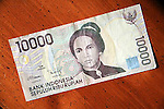 Indonesia 10000 Rupiah currency note on table