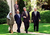 From left to right: Chairman Yassir Arafat of the Palestinian Authority, King Hussein of the Hashemite Kingdom of Jordan, United States President Bill Clinton, and Prime Minister Benyamin Netanyahu of Israel leave the Oval Office at The White House in Washington, DC after their talks on October 1, 1996. Looking on in the background at upper left is US Vice President Al Gore.<br /> Credit: Ron Sachs / CNP