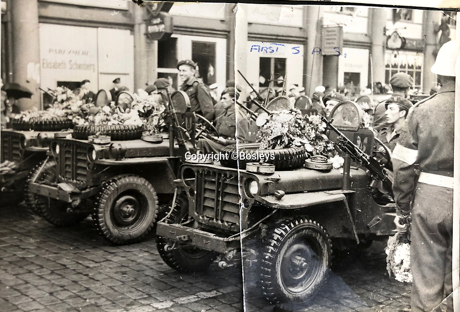 BNPS.co.uk (01202 558833)<br /> Pic: Bosleys/BNPS<br /> <br /> Trooper Casey's photo album - Rare picture of 1st SAS parading in their heavily armed jeeps in Norway at the end of the war.<br /> <br /> Sold for £25,000 - An extraordinary wartime archive that lift's the veil on the earliest days of the SAS during WW2.<br /> <br /> The late Fred Casey was among the original dozen members of the 1st Special Air Service that was formed in North Africa to wreak havoc behind enemy lines.<br /> <br /> The commando's military possessions included a remarkable album containing previously unseen images of the founding members of the elite force.<br /> <br /> Legendary Captain David Stirling, who formed the 'Who Dares Wins' regiment, and hand-picked the men under his command, is pictured along with his controversial deputy Paddy Mayne , who took over the top secret regiment after Stirling's capture.<br /> <br /> The album sold at Bosley's Auctioneers of Marlow, Bucks, last week for over five times its pre-sale estimate..