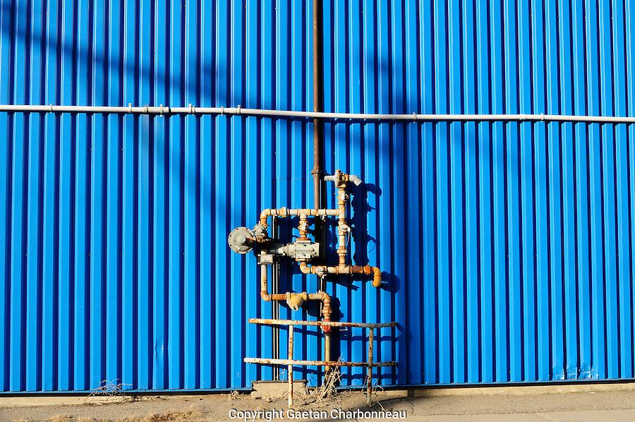 Gaz pipe over a blue aluminium background