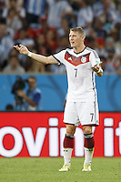 Bastian Schweinsteiger of Germany shouts to his players