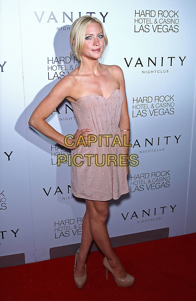 Brittany Snow. walks the red carpet at Vanity Nightclub inside the Hard Rock Hotel and Casino, Las Vegas, NV,19th August 2011..full length beige strapless dress hand on hip  platform patent shoes .CAP/ADM/MJT.© MJT/AdMedia/Capital Pictures.