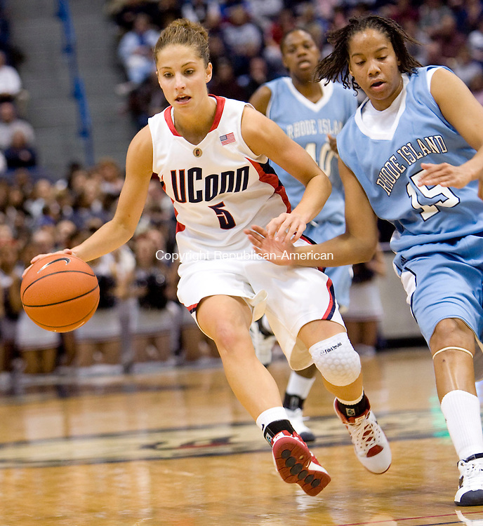 HARTFORD, CT - 22 NOVEMBER 2008 -112208JT02-<br /> UConn's Caroline Doty dribbles past Rhode Island's Lindsay Harris during Saturday's game at the XL Center in Hartford. The Huskies won, 91-43.<br /> Josalee Thrift / Republican-American