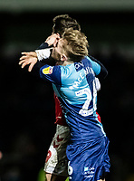 Wycombe Wanderers' Jason McCarthy (right) is struck in the face during a challenge by Fleetwood Town's Ched Evans who subsequently received a red card for the offence<br /> <br /> Photographer Andrew Kearns/CameraSport<br /> <br /> The EFL Sky Bet League One - Wycombe Wanderers v Fleetwood Town - Tuesday 11th February 2020 - Adams Park - Wycombe<br /> <br /> World Copyright © 2020 CameraSport. All rights reserved. 43 Linden Ave. Countesthorpe. Leicester. England. LE8 5PG - Tel: +44 (0) 116 277 4147 - admin@camerasport.com - www.camerasport.com