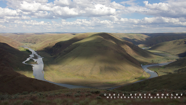 Cloud shadows drift into the John Day River canyon as it cuts through the Columbia Plateau of Oregon.