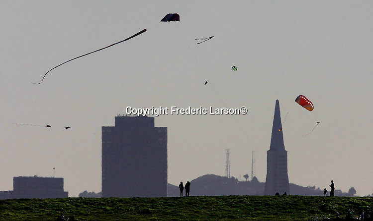 On a spring like March day people are sailing kites off of point Isabella in Albany California..