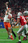 Clemson Tigers quarterback Trevor Lawrence (16) jumps and unleashes a pass during the Fiesta Bowl game against the Ohio State Buckeyes on Saturday, Dec 28, 2019 in Glendale, Ariz.  (Gene Lower via AP)