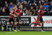Joshua King of Bournemouth (R) celebrates his goal during the Barclays Premier League match between Swansea City and Bournemouth at the Liberty Stadium, Swansea on November 21 2015