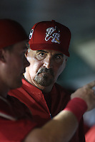 Palm Beach Cardinals pitching coach Randy Niemann (40) listens to Carson Kelly in the dugout during a game against the Lakeland Flying Tigers on April 13, 2015 at Joker Marchant Stadium in Lakeland, Florida.  Palm Beach defeated Lakeland 4-0.  (Mike Janes/Four Seam Images)