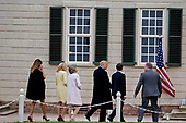 Doug Bradburn, president and chief executive officer of George Washington's Mount Vernon, from right, Emmanuel Macron, France's president, U.S. President Donald Trump, Sarah Miller Coulson, regent with the Mount Vernon Ladies Association, Brigitte Macron, France's first lady, and U.S. First Lady Melania Trump tour outside the Mansion at the Mount Vernon estate of first U.S. President George Washington in Mount Vernon, Virginia, U.S., on Monday, April 23, 2018. As Macron arrives for the first state visit of Trump's presidency, the U.S. leader is threatening to upend the global trading system with tariffs on China, maybe Europe too. <br /> Credit: Andrew Harrer / Pool via CNP