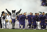 Oct 30, 20010:  Washington cheerleaders lead the football team out onto the field against Stanford.  Stanford defeated Washington 41-0 at Husky Stadium in Seattle, Washington.
