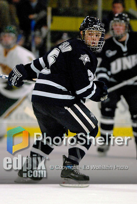 """5 January 2007: University of New Hampshire defenseman Kevin Kapstad (5) from Boxboro, MA, in action against the University of Vermont Catamounts at Gutterson Fieldhouse in Burlington, Vermont. The UNH Wildcats defeated Vermont 7-1 in front of a record setting 48th consecutive sellout at """"the Gut""""...Mandatory Photo Credit: Ed Wolfstein Photo.<br />"""