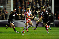 Greig Laidlaw of Gloucester Rugby chips between Sam Hidalgo-Clyne and Dougie Fife of Edinburgh Rugby