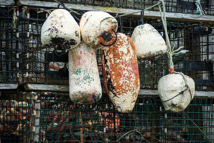 Weather-beaten lobster trap floats on a dock in Peggy's Cove, Nova Scotia