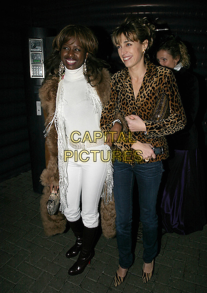 JUNE SARPONG & GUEST.Why Not? Charity Event, Westbourne Studios, London, UK..November 24th, 2005.Ref: AH.full length brown boots leather fur trimmed coat white trousers top.www.capitalpictures.com.sales@capitalpictures.com.© Capital Pictures.