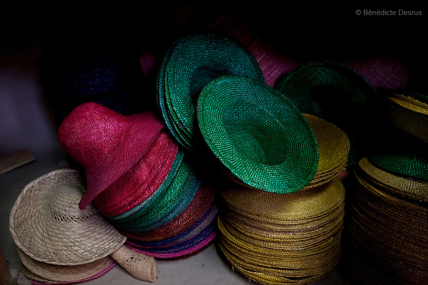9 december 2009 - Coustilleres' hat factory, Septfonds, France - Colored straw hats..Septfonds is the heart of French straw hat making, due to its very ancient hatter tradition. The hat making industry had its commercial peak in the late 19th century..Coustillères is a family owned hat making factory that has been making straw hats in Septfonds for nearly 100 years. They make hats from straw, felt, and cloth as well as caps. The current owner is Jean-Claude Coustilleres. He is one of the last hat makers of the region..The straw hat making process is very labor intensive and numerous hands are involved. Nearly all of the equipment is over 100 years old, they use the original presses and tools including aluminium molds and sewing machines and dye their own straw continuing the traditional methods of manufacturing. The hat blocking and shaping, straw braids construction and dyeing are all done by hand..The company works on behalf of fashion houses and makes a variety of regional and historical hats. It produces 2 collections a year distributed by a network of salespeople and through a catalog to clients around the world. Photo credit: Benedicte Desrus