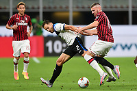 Ante Rebic of AC Milan and Rafael Toloi of Atalanta BC compete for the ball during the Serie A football match between AC Milan and Atalanta BC at stadio Giuseppe Meazza in Milano ( Italy ), July 24th, 2020. Play resumes behind closed doors following the outbreak of the coronavirus disease. <br /> Photo Image Sport / Insidefoto