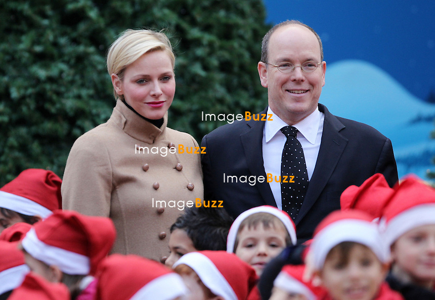 Princess Charlene of Monaco and Prince Albert II of Monaco attend the Christmas Celebration For Monaco Children on December 12, 2012 in Monaco, Monaco.  .