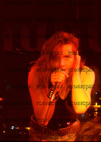 GIRL - vocalist Phil Lewis - performing live at the Marquee Club in London UK - Apr 1980.  Photo credit: George Chin/IconicPix