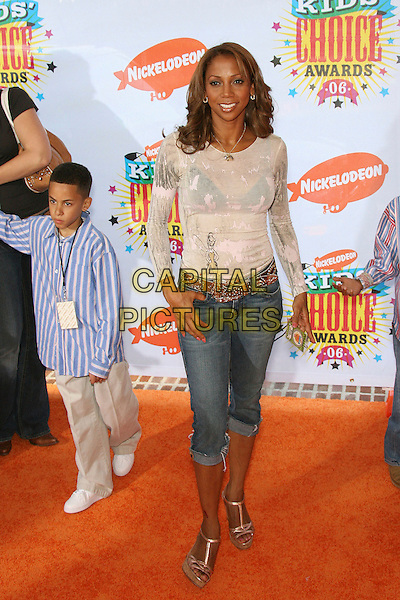 HOLLY ROBINSON PEETE.Nickelodeon's 19th Annual Kids' Choice Awards held at Pauley Pavilion, Westwood, California, USA.  .April 1st, 2006.Photo: Zach Lipp/AdMedia/Capital Pictures.Ref: ZL/ADM.full length jeans denim rolled up cropped.www.capitalpictures.com.sales@capitalpictures.com.© Capital Pictures.