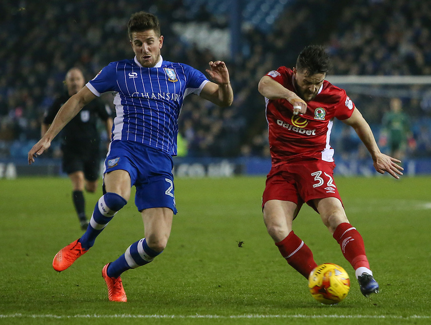 Blackburn Rovers' Craig Conway gets a shot away under pressure from Sheffield Wednesday's Sam Hutchinson<br /> <br /> Photographer Alex Dodd/CameraSport<br /> <br /> The EFL Sky Bet Championship - Sheffield Wednesday v Blackburn Rovers - Tuesday 14th February 2017 - Hillsborough - Sheffield<br /> <br /> World Copyright &copy; 2017 CameraSport. All rights reserved. 43 Linden Ave. Countesthorpe. Leicester. England. LE8 5PG - Tel: +44 (0) 116 277 4147 - admin@camerasport.com - www.camerasport.com