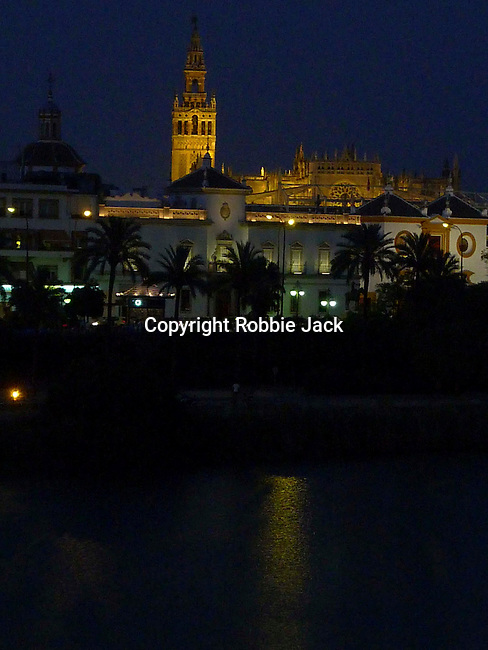 A night view across the Gaudalquivir in Seville, Spain.