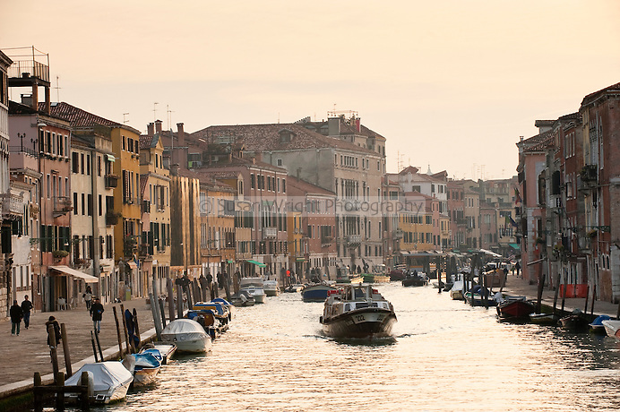 Ferries and fishing boats along the Cannaregio Canal, or 'Canale di Cannaregio' in the Cannaregio district of Venice, Italy