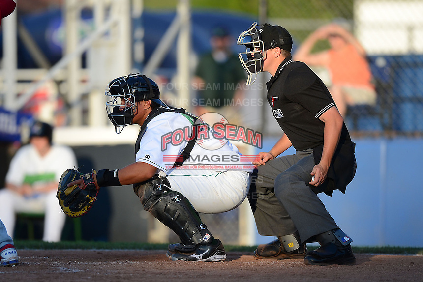 Jamestown Jammers catcher Jin-De Jhang #47 and umpire Brennan Miller during a game against the Williamsport Crosscutters on June 20, 2013 at Russell Diethrick Park in Jamestown, New York.  Jamestown defeated Williamsport 12-6.  (Mike Janes/Four Seam Images)