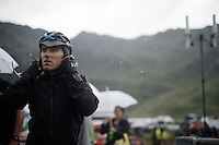 After being soaked to the bone in the last part of the race, many riders, like Geraint Thomas (GBR/SKY) here, quickly change into some dryer clothes after finishing before descending towards Andorra again (as the team buses weren't allowed up the finishing mountain climb). <br /> <br /> finish of stage 9 in Andorra Arcalis (coming from Velha Val d'Aran/ESP, 184km)<br /> 103rd Tour de France 2016