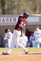 Daniel Aldrich #32 of the College of Charleston Cougars follows through on his swing against the Davidson Wildcats at Wilson Field on March 12, 2011 in Davidson, North Carolina.  The Wildcats defeated the Cougars 8-3.  Photo by Brian Westerholt / Four Seam Images