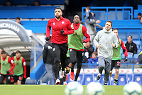 Troy Deeney leads out the Watford team for the pre-match warm up during Chelsea vs Watford, Premier League Football at Stamford Bridge on 5th May 2019