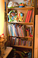 Bookcase in children's bedroom. Balucki District Lodz Central Poland