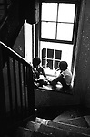 Children playing in the stairwell of a tenement building in the city of Long Beach, NY. Photo by Jim Peppler. Copyright/Jim Peppler/1969.