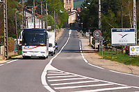 The entrance to Ampuis with road sign saying that this is Cote Rotie, in the Cotes du Rhone a tours bus on the road. Ampuis, Cote Rotie, Rhone, France, Europe