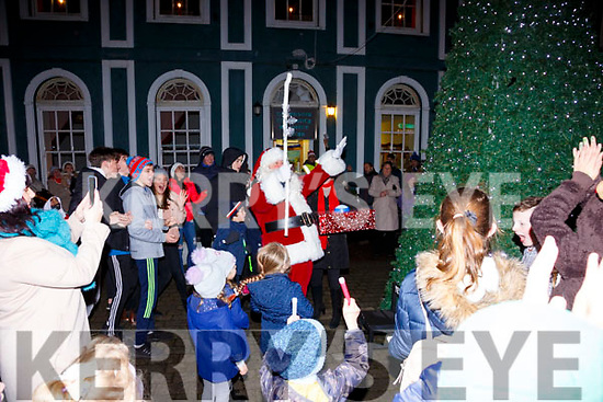 Santa hits the big button to turn on the lights in Cahersiveen on Friday the 8th of December.