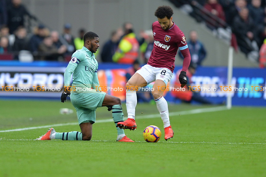 Ainsley Maitland-Niles of Arsenal and Felipe Anderson during West Ham United vs Arsenal, Premier League Football at The London Stadium on 12th January 2019