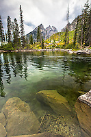 The crystal clear water of Cottonwood Creek in Grand Teton National Park.  The Cathedral Group of the Grand Tetons towers above.<br />