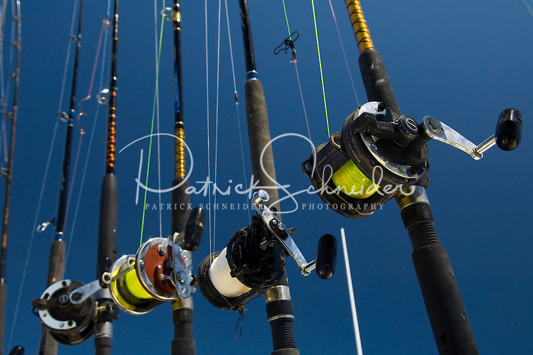 Fishing poles wait on deck to be used in Amelia Island, FL
