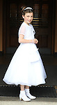 Amy Kelly pictured at the Lourdes Church on her First Communion day.