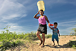 A woman carries water home from a river near Santa Paula, a hot and isolated village in northwestern Nicaragua.
