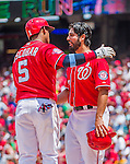 21 June 2015: Washington Nationals starting pitcher Gio Gonzalez greets Yunel Escobar after scoring on Escobar's 3-run homer in the first inning against the Pittsburgh Pirates at Nationals Park in Washington, DC. The Nationals defeated the Pirates 9-2 to sweep their 3-game weekend series, and improve their record to 37-33. Mandatory Credit: Ed Wolfstein Photo *** RAW (NEF) Image File Available ***