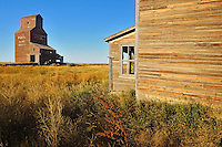 Old general store and grain elevator in ghost town<br /> Bents<br /> Saskatchewan<br /> Canada