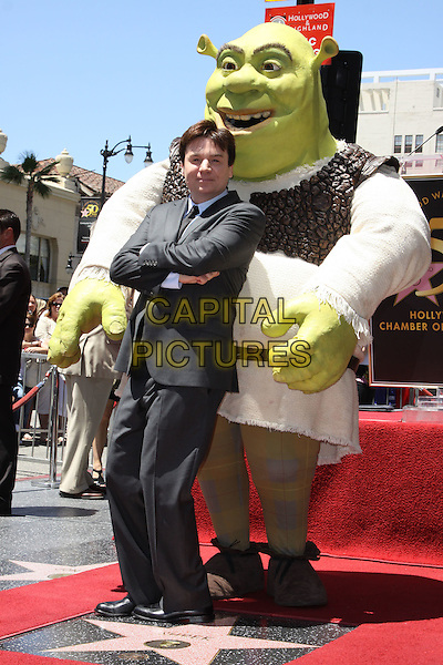 MIKE MYERS & SHREK.Shrek honoured with the 2408th star on the Hollywood Walk of Fame held On Hollywood Blvd., Hollywood, California, USA..May 20th, 2010.full length grey gray suit costume arms crossed .CAP/ADM/KB.©Kevan Brooks/AdMedia/Capital Pictures.