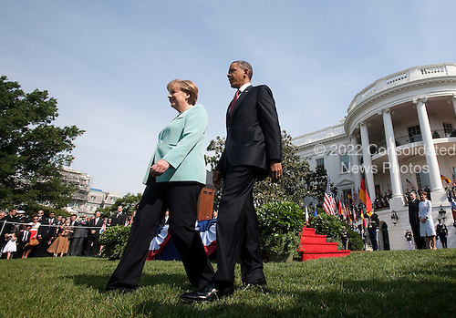 United States President Barack Obama and Angela Merkel, chancellor of Germany, take part in an arrival ceremony at the White House in Washington, D.C., U.S., on Tuesday, June 7, 2011. .Credit: Andrew Harrer / Pool via CNP