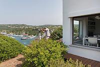Danilo Pitton on the terrace of his house in Santa Teresa di Gallura, looking through a telescope