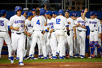 Florida Gators Brady McConnell (4) congratulated by teammates after hitting a home run during a game against the Siena Saints on February 16, 2018 at Alfred A. McKethan Stadium in Gainesville, Florida.  Florida defeated Siena 7-1.  (Mike Janes/Four Seam Images)