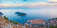 Panoramic Photo of Dubrovnik Old Town and Lokrum Island at sunset, Dalmatian Coast, Croatia, Europe. This panoramic photo shows Dubrovnik Old Town and Lokrum Island at sunset, just off the coast of Dubrovnik Old Town on the Dalmatian Coast of Croatia. This photo was taken at sunset from Mount Srd, which offers by far the most beautiful views of Dubrovnik Old Town and Lokrum Island, situated in the Mediterranean Sea on the Adriatic Coast of Croatia.