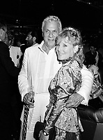 LONDON, UK. c. 1986: Actor Tony Curtis & singer Petula Clark at a party in London.<br /> © Paul Smith/Featureflash