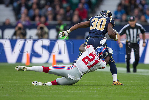 23.10.2016. Twickenham, London, England. NFL International Series. New York Giants versus LA Rams. New York Giants defensive back Landon Collins tackles Los Angeles Rams running back Todd Gurley.