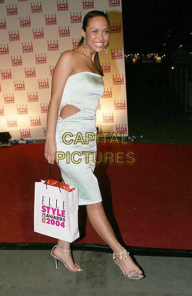 MYLEENE KLASS.Elle Style Awards 2004 at the Natural History Museum.16 February 2004.full length, full-length, white satin dress, cut away, goodie bag, goody bag, silver strappy sandals.www.capitalpictures.com.sales@capitalpictures.com.© Capital Pictures.